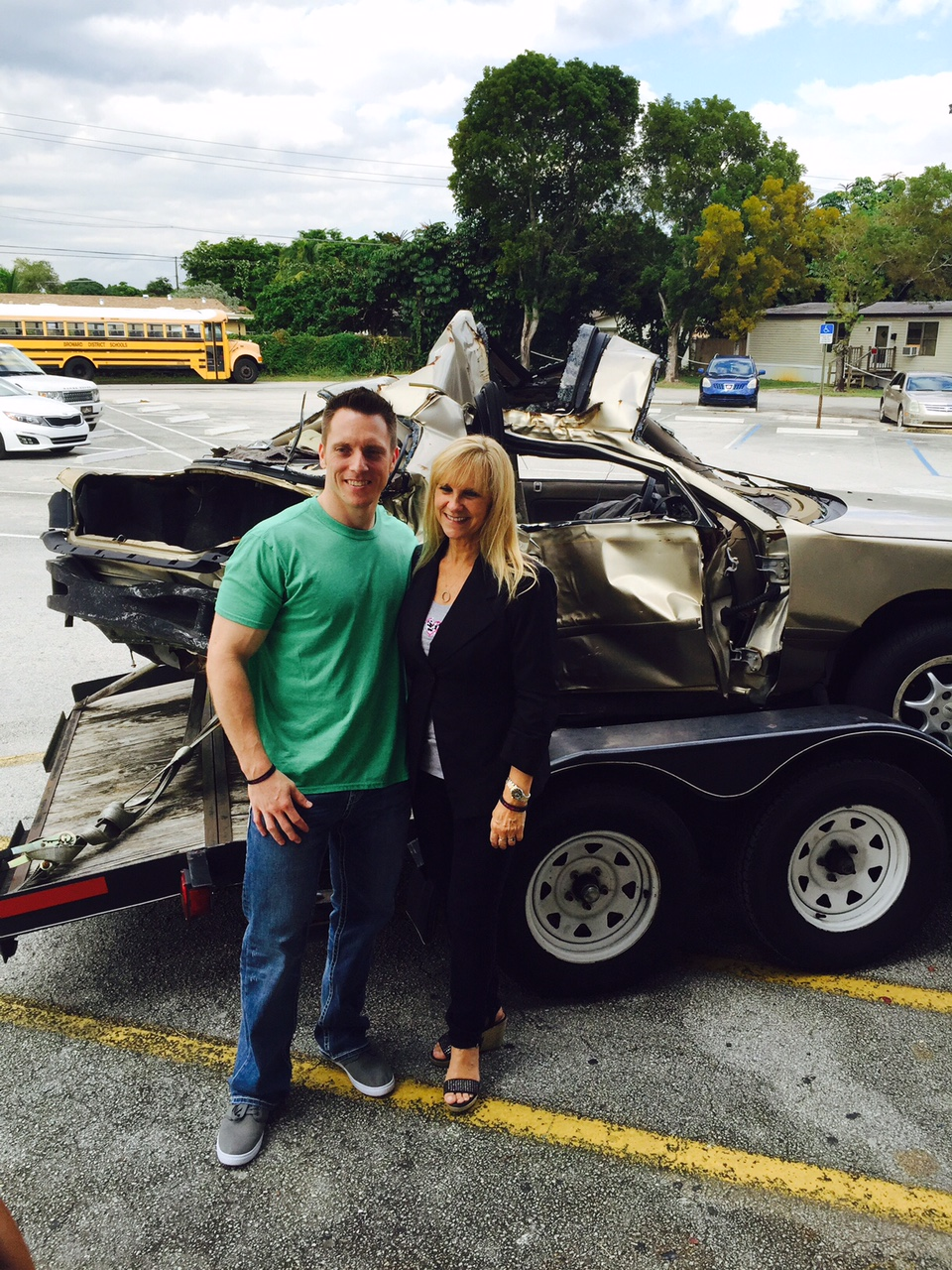 Renee-and-Eric-w-wrecked-car